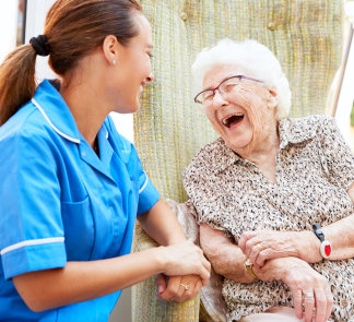 caregiver and senior woman laughing