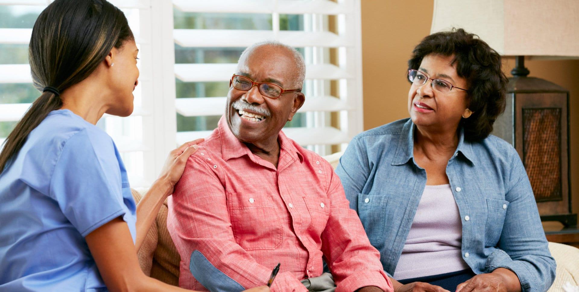 caregiver visiting senior couple